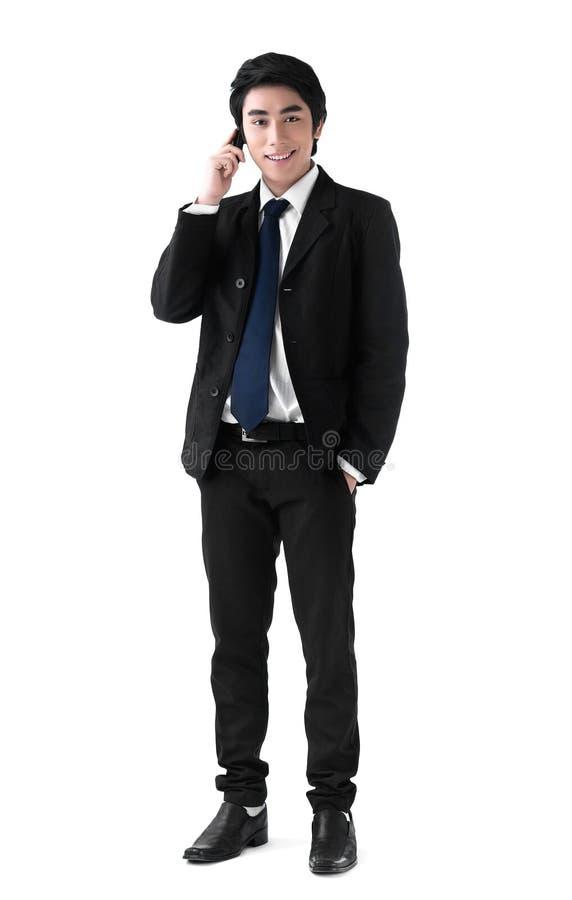 Ein Geschäftsmann am Telefon stockbild