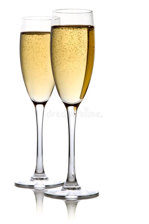 Ein Glas Champagner, getrennt auf einem Weiß stockfotografie