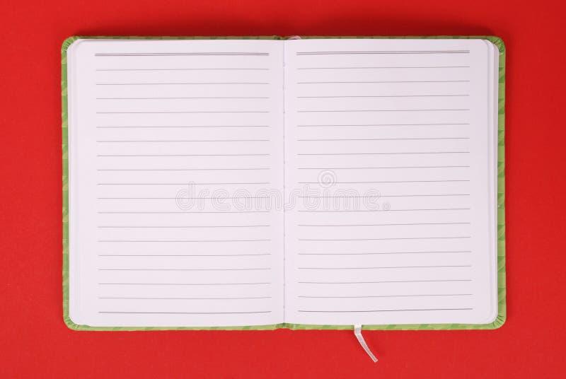 Ein grünes Notizbuch stockfotografie