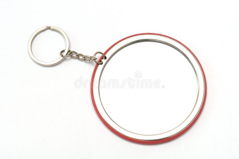 Ein großes rundes keychain mit Spiegel am hinteren Gesicht lizenzfreie stockfotos