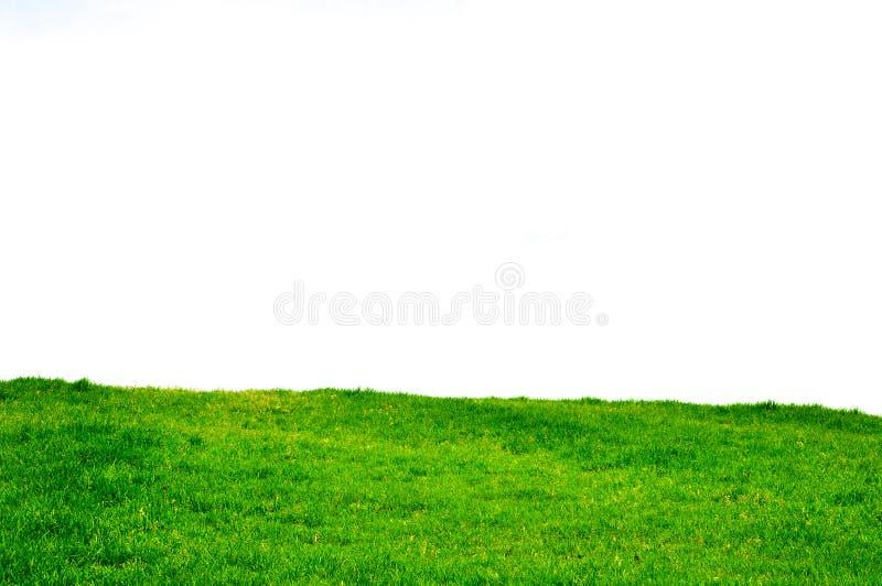 Ein gro?er und sauberer Rasen durch Himmel lizenzfreie stockbilder