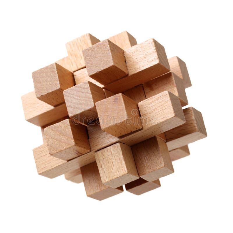 Ein hölzernes Puzzlespiel mit weißem Farbhintergrund Dieses Bild kann für Teamwork oder Integration zwischen Parteien/Software ve lizenzfreie stockfotos