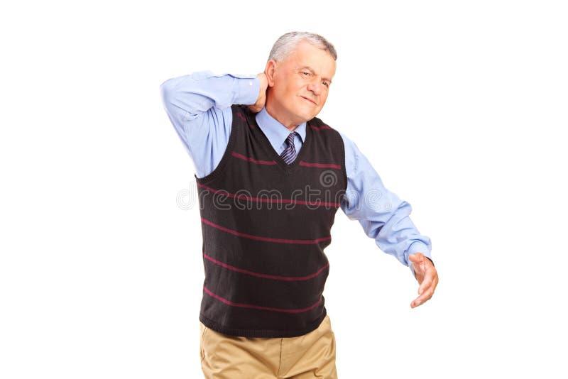 Ein Herr, Der Unter Nackenschmerzen Leidet Stockfotografie