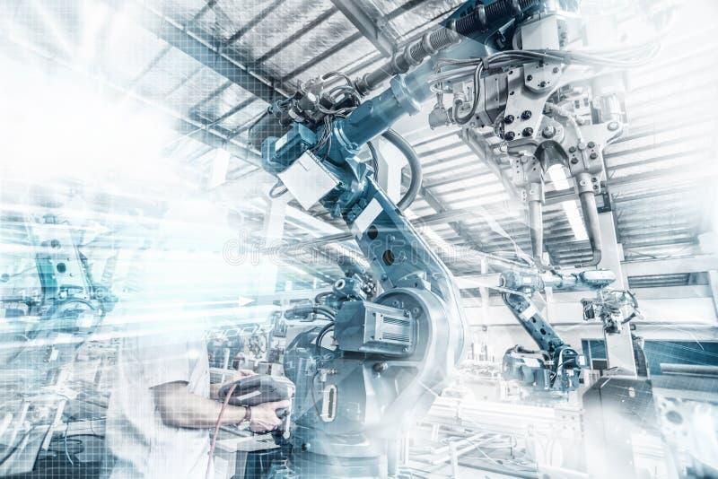 Ein Industrieroboter in einer Werkstatt lizenzfreies stockfoto