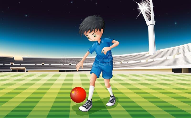 Ein Junge, der Fußball am Feld spielt lizenzfreie abbildung