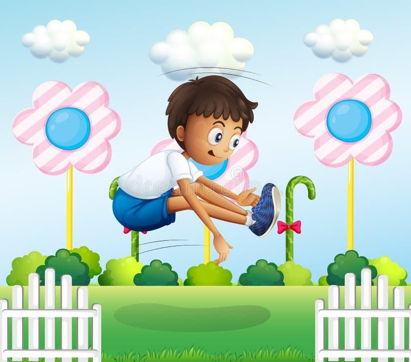 Ein Junge, der nahe dem Zaun springt stock abbildung