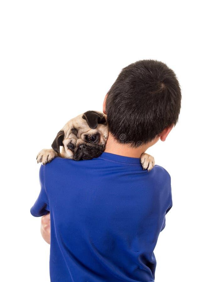 Download Ein Junge, Der Seinen Hund Anhält Stockbild - Bild von junge, jugendlich: 27731019
