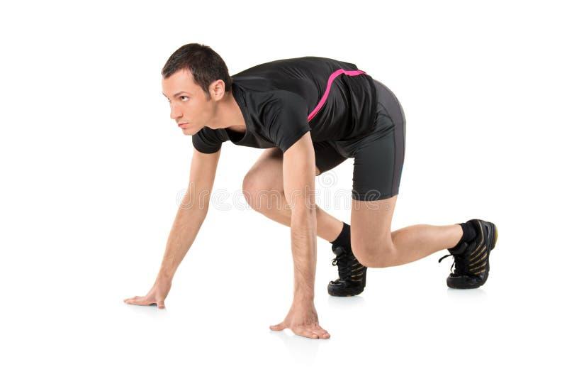 Ein junger Athlet betriebsbereit zu laufen lizenzfreies stockbild