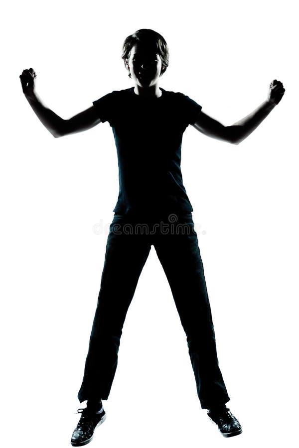 Ein junges Jugendlichjungen- oder -mädchenschattenbild glücklich lizenzfreie stockfotografie