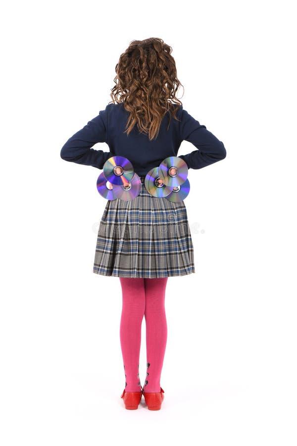 Ein junges Schulmädchen mit Lockenhaarholding CD oder dvd stockfoto
