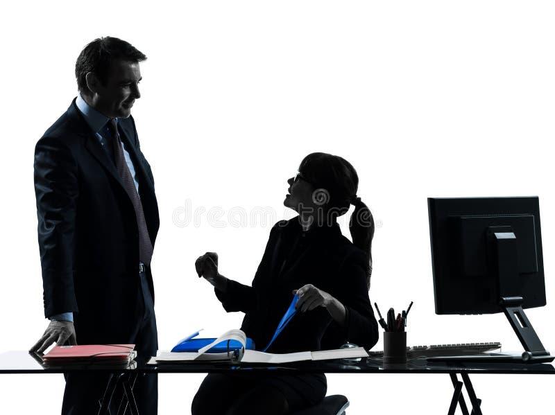Beschäftigtes lächelndes Geschäftsfrau-Mannpaarschattenbild stockfotografie