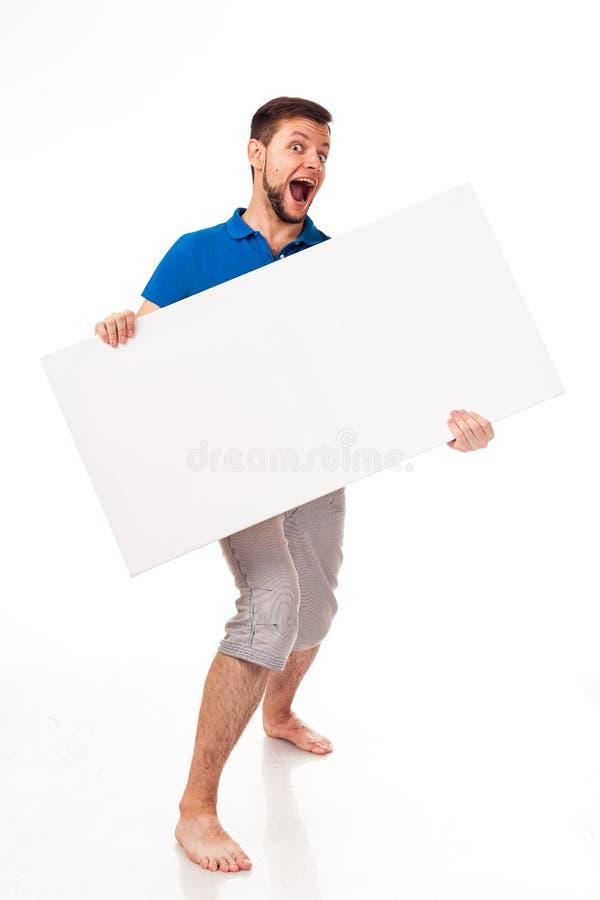 Ein Kerl mit einem Bart, der mit einem weißen Zeichen aufwirft Kann verwendet werden, um Werbung, Logo und anderes zu setzen Ange stockbilder