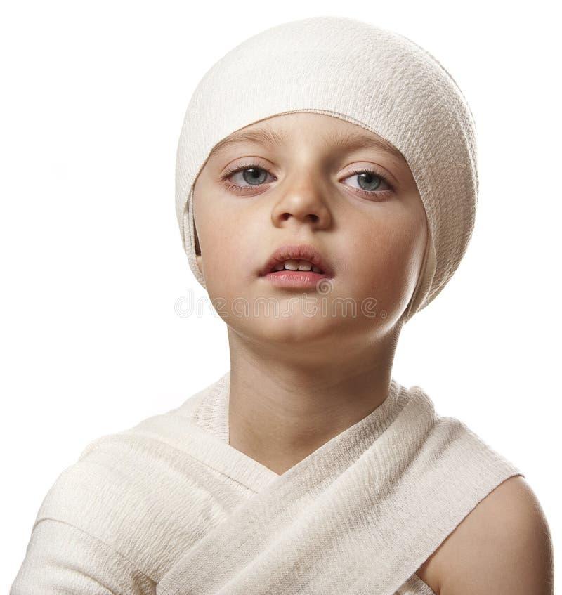 Ein Kind mit einem Verband stockbilder