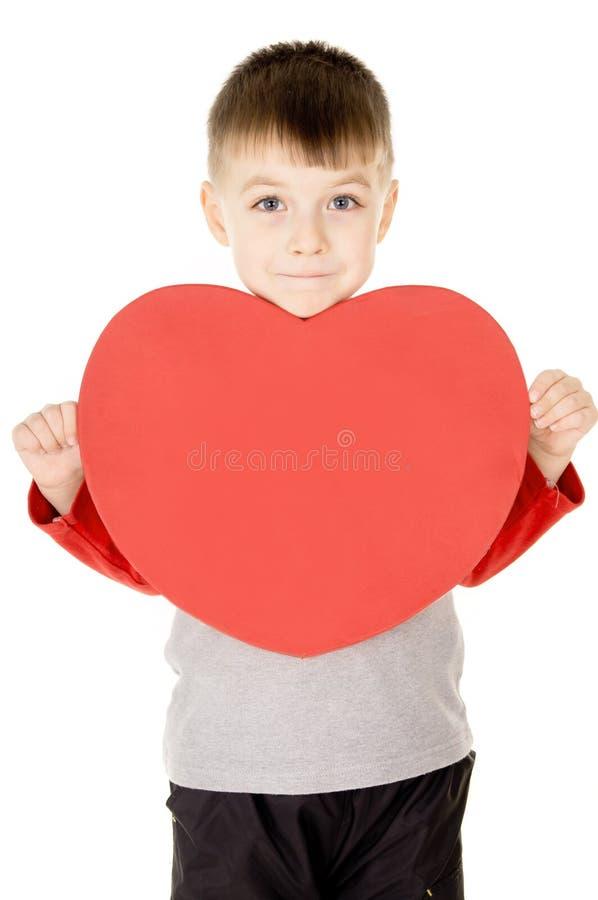 Ein kleines Kind steht und hält das Innere an lizenzfreies stockbild