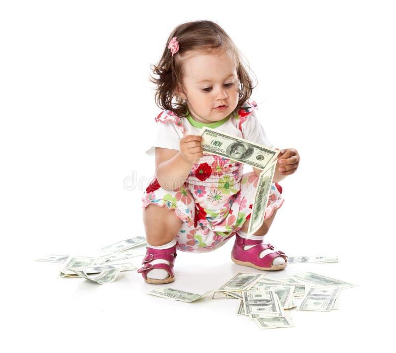 Ein kleines Mädchen mit Geld lizenzfreies stockfoto