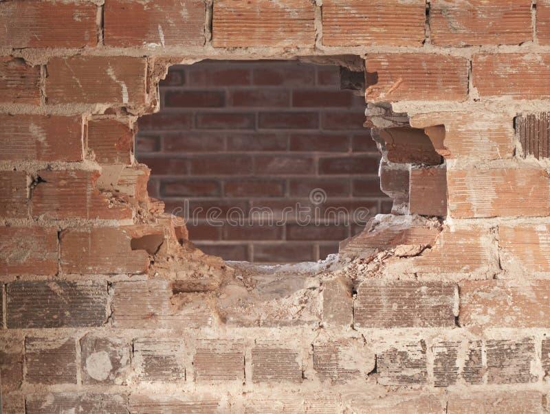 Ein Loch in der Wand lizenzfreie stockfotos