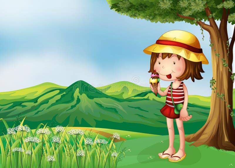 Ein Mädchen, das eine Eiscreme an der Spitze der Hügel isst lizenzfreie abbildung