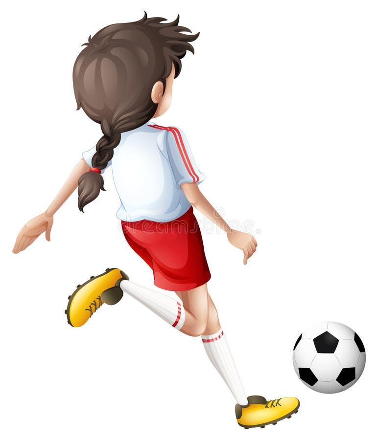 Ein Mädchen, das einen Fußball tritt lizenzfreie abbildung