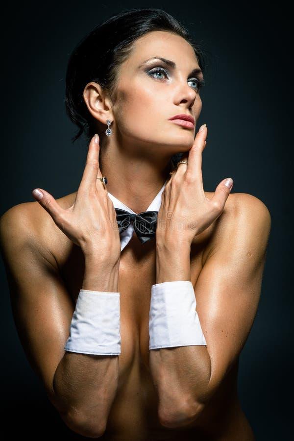 Ein Mädchen weared als Playboy lizenzfreie stockfotografie