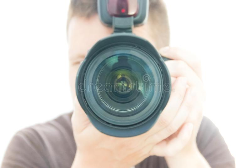 Ein Mannphotograph With ein Kamera Schießen lizenzfreie stockfotos