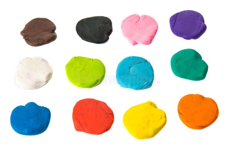 Ein modellierender Lehmball von verschiedenen Farben stockbilder