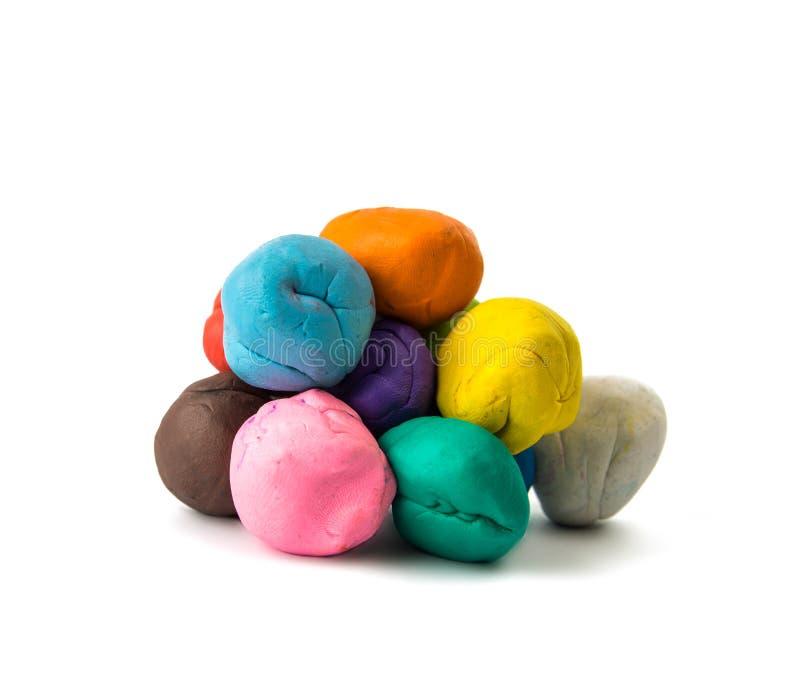 Ein modellierender Lehmball von verschiedenen Farben stockfoto