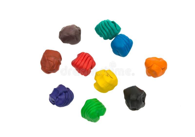 Ein modellierender Lehmball von verschiedenen Farben lizenzfreie stockbilder