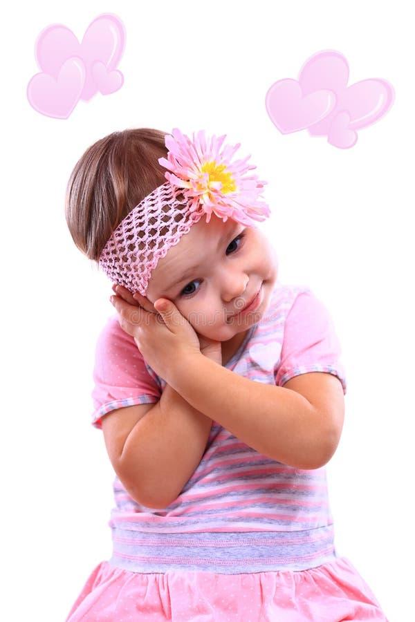 Ein Nahaufnahmeporträt eines glücklichen kleinen Mädchens lizenzfreie stockfotografie