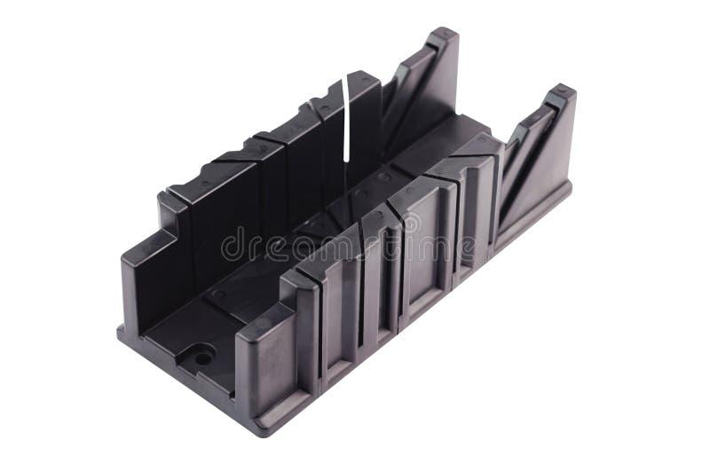 Ein neuer schwarzer Plastikgehrungsfugenkasten für den Winkelschnitt lokalisiert auf weißem Hintergrund stockfoto