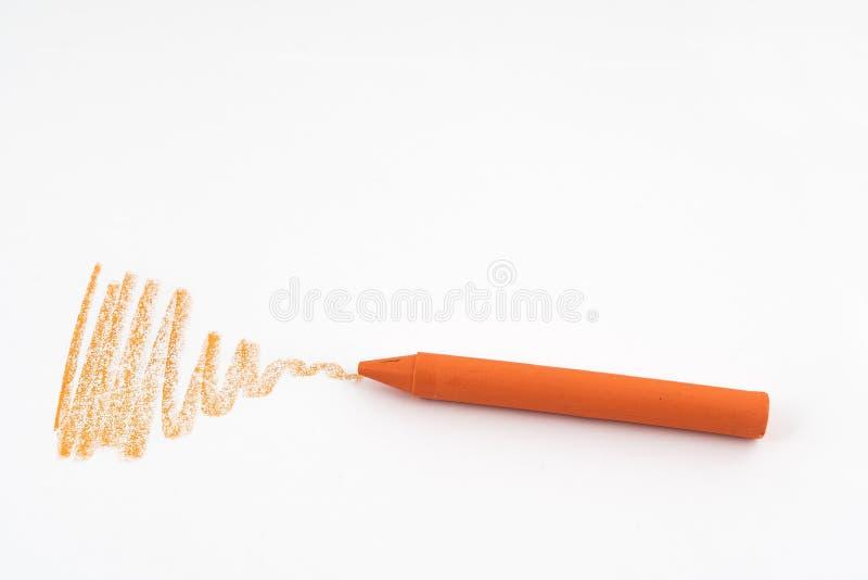 Ein orange Wachszeichenstift lizenzfreie stockfotografie