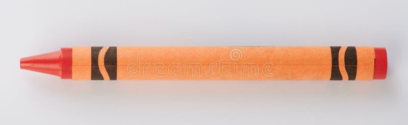 Ein orange Zeichenstift stockfotos