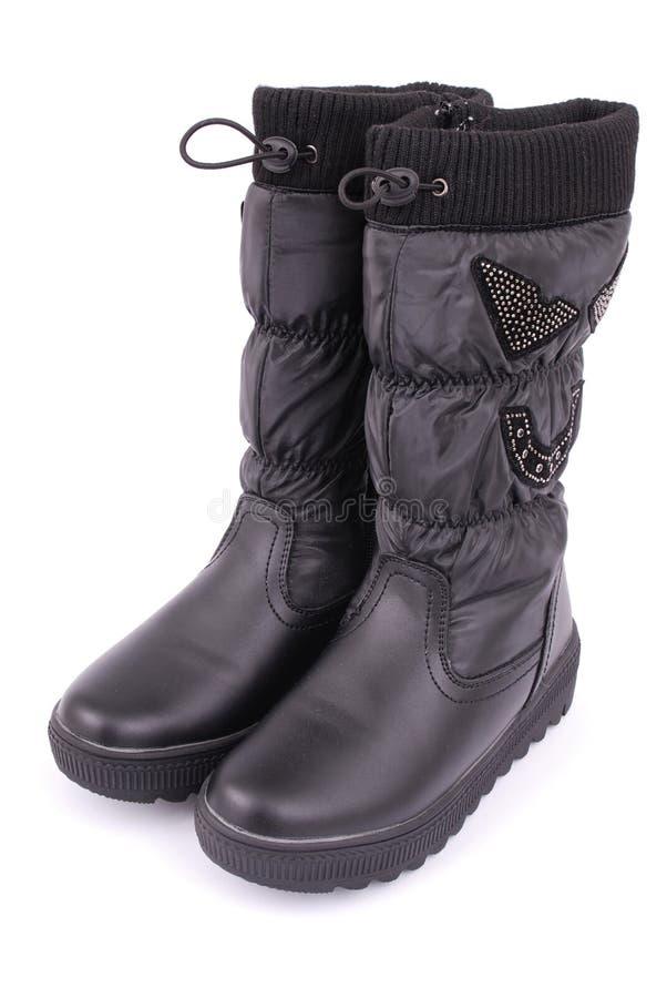Ein Paar schwarze Stiefel für Kinder stockbild