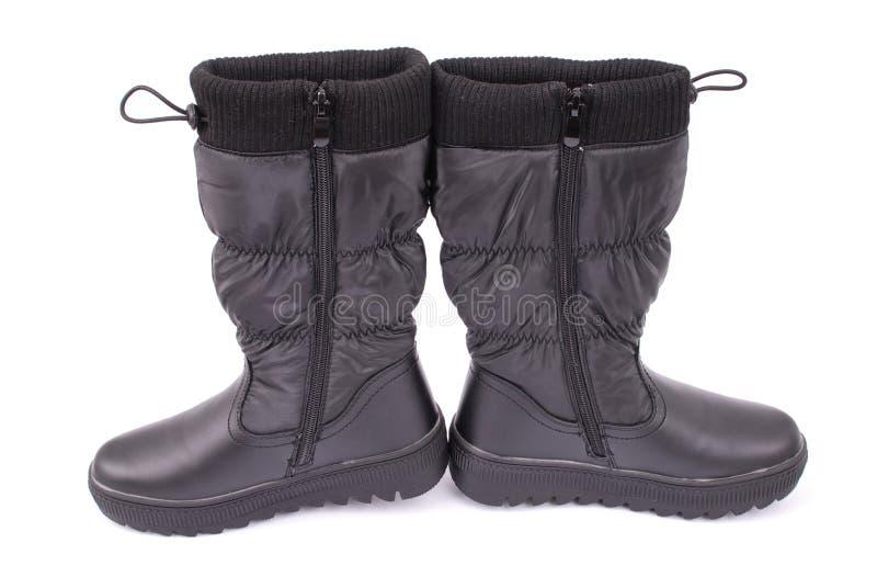 Ein Paar schwarze Stiefel für Kinder lizenzfreies stockfoto