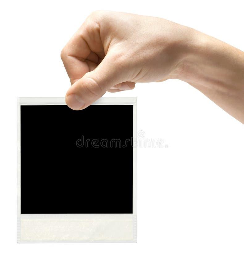 Ein Polaroid in der Hand lizenzfreie stockbilder