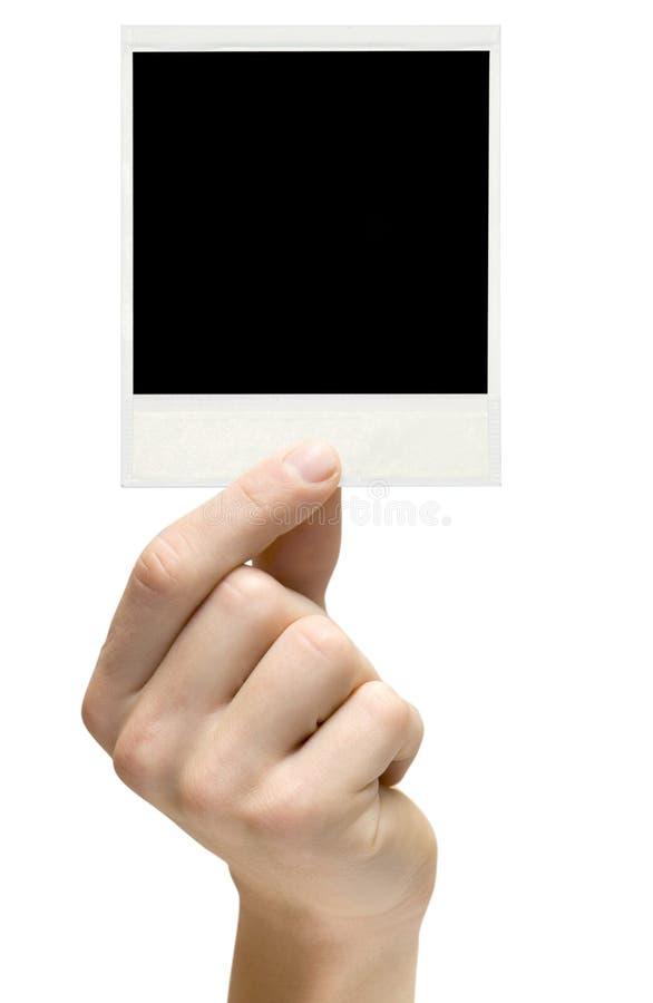 Ein Polaroid in der Hand stockfotos