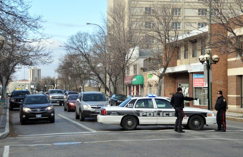 Ein Polizeiwagen blockiert die Straße stockfoto
