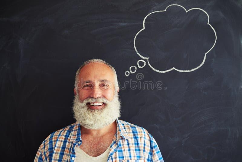 Ein Porträt des begeisterten älteren Mannes stockbilder