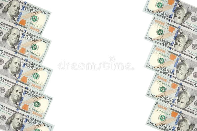 Ein Rahmen von zwei Reihen von Rechnungen von hundert Dollar Weißer Hintergrund auf Mittellinie lizenzfreies stockbild