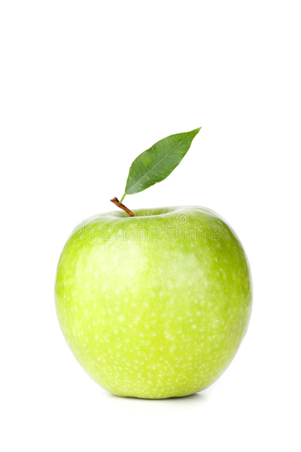 Ein reifer grüner Apple mit Blatt stockfotos