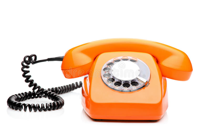 Ein Retro- orange Telefon lizenzfreie stockfotos