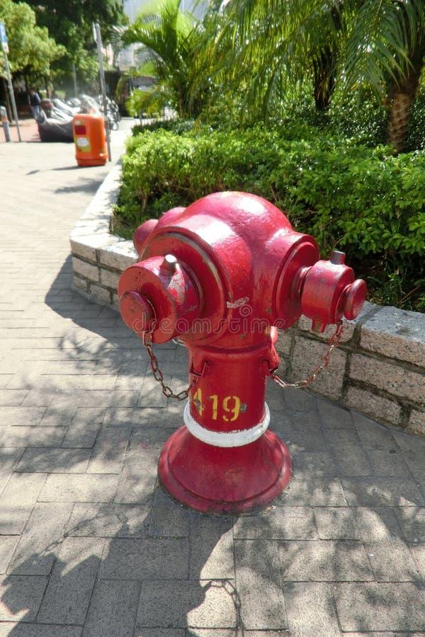 Ein roter Hydrant bei Hong Kong stockbilder