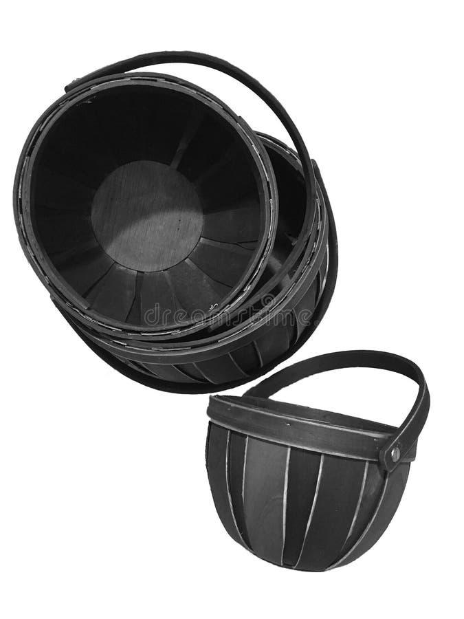 Ein Satz schwarze gesponnene Körbe mit Griff stockfotografie