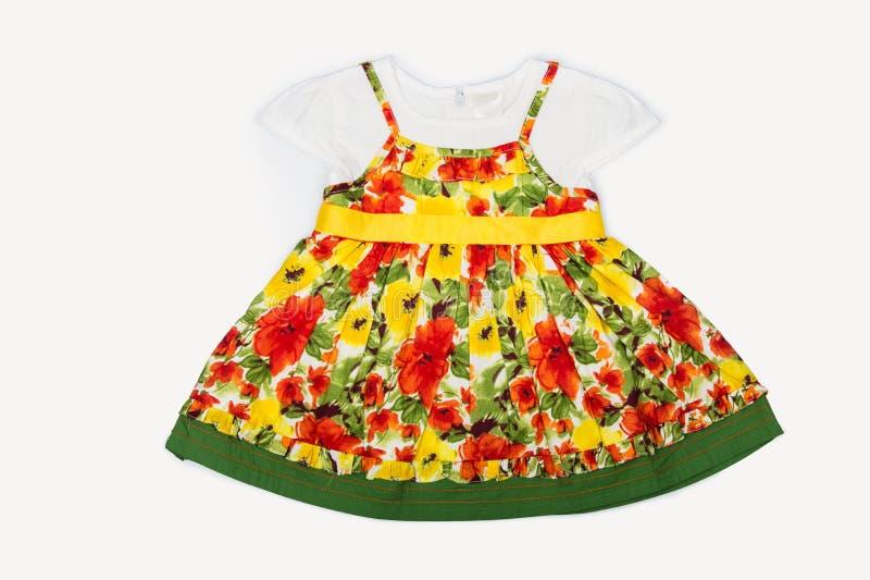 Ein schöne Baby-Mehrfarbenblumenkleid-Ideal Sprin stockfotografie