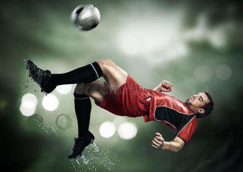 Ein schöner und netter Fußballspieler lizenzfreies stockbild