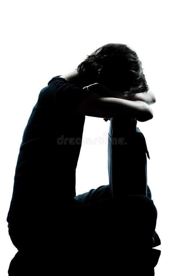 Ein schreiendes trauriges Schattenbild des jungen Jugendlichmädchens lizenzfreies stockbild