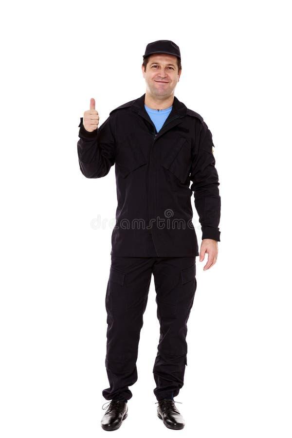 Ein Sicherheitsbeamte mit einem Daumen herauf Zeichen stockfotos
