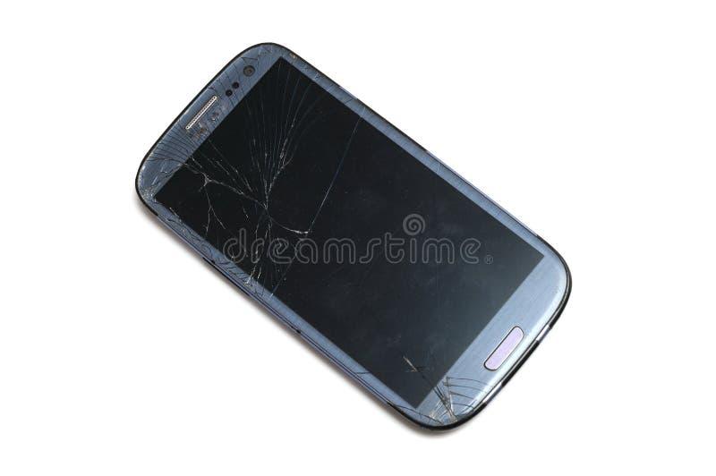Ein Smartphone mit zerbrochener Schirmoberfläche stockbild