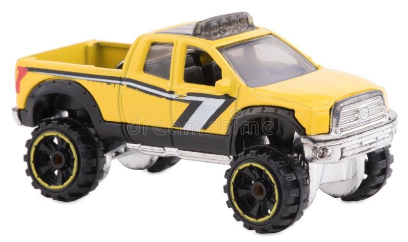 Ein Spielzeugauto in der schwarzen und gelben Farbe Lokalisiert auf Weiß lizenzfreie stockfotos