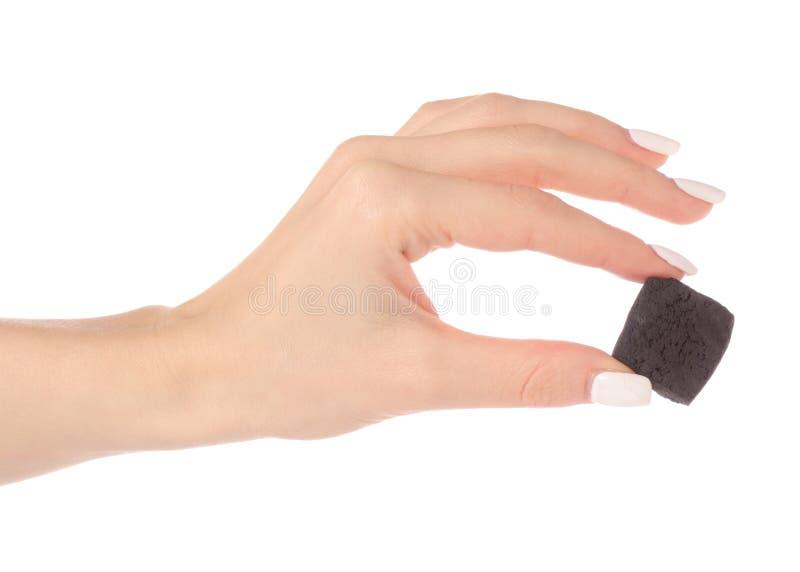 Ein Stück Kohle in der Hand stockbilder