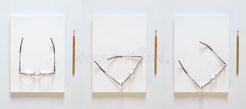 Ein Stapel leere Blätter Papier Bleistift und Gläser in den verschiedenen Positionen auf einem weißen Hintergrund stockfotos